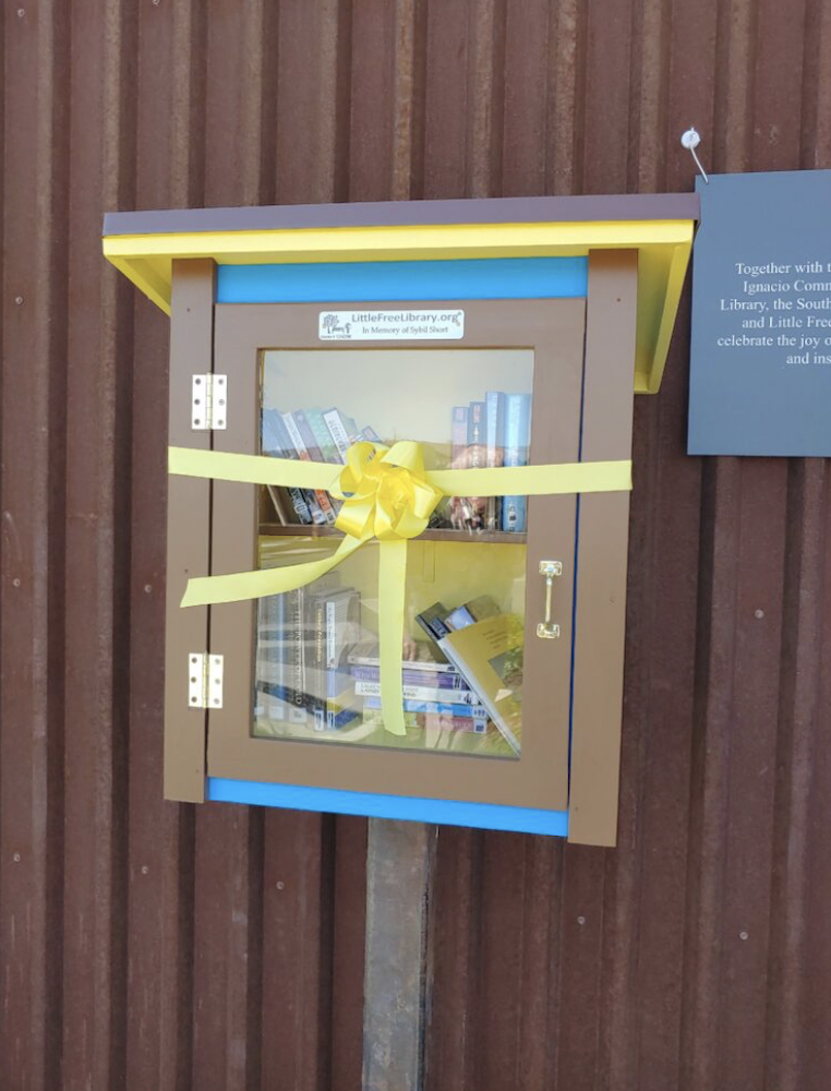 The Little Free Library at Sunnyside Market with her dedication ribbon.