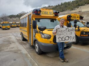 Food Program poster and bus driver